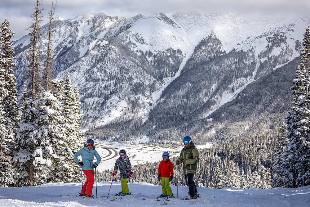 A family of four on a snowy trail at Copper Mountain Resort