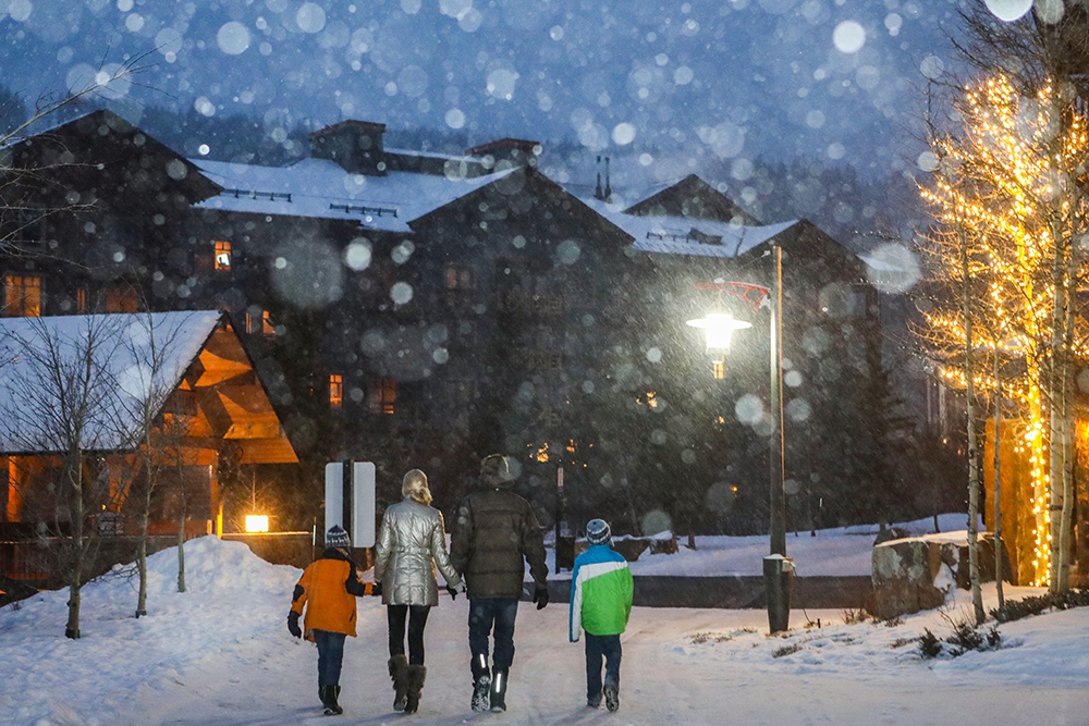 A family of four walks through Copper's Center Village, Copper Mountain Colorado