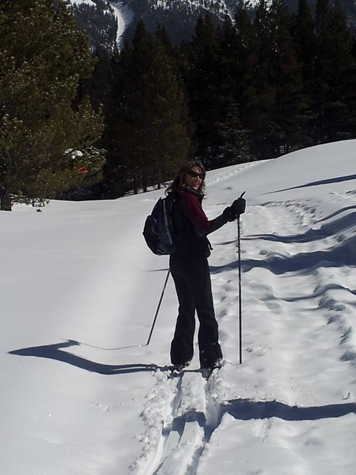 Blogger Tracy Greenhalgh walks through fresh snow on a snowshoe tour at Copper Mountain Ski Resort