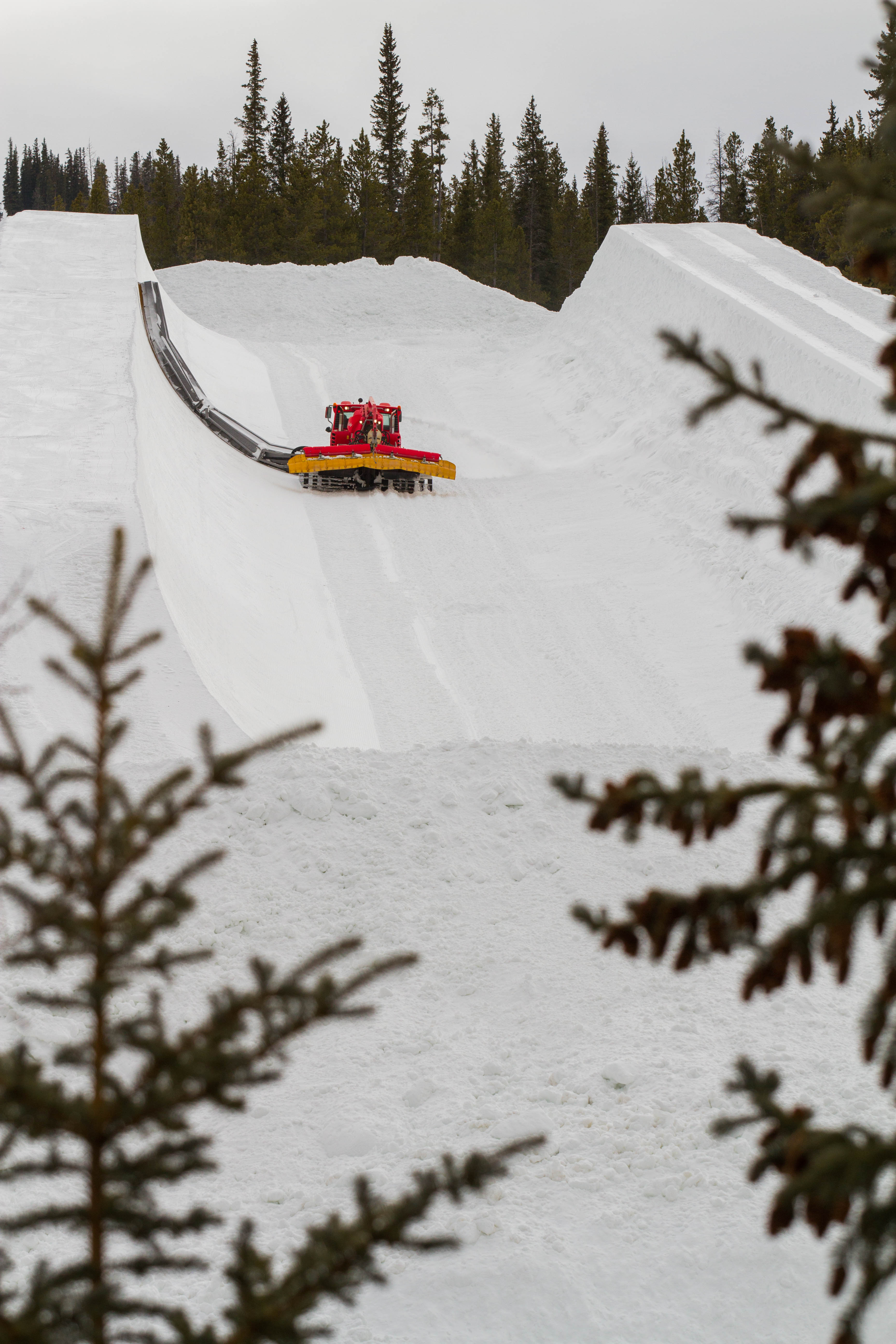 A snowcat works on the halfpipe at Copper Mountain in Colorado