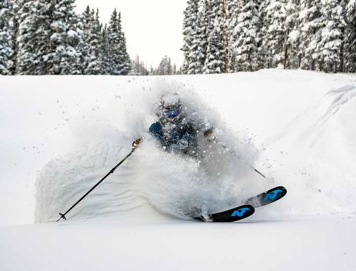 Content Coordinator Curtis DeVore takes a powder run on skis at Copper Mountain
