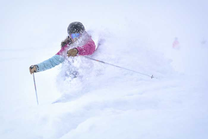 Marketing Manager Stephanie Sweeney takes a deep powder run at Copper