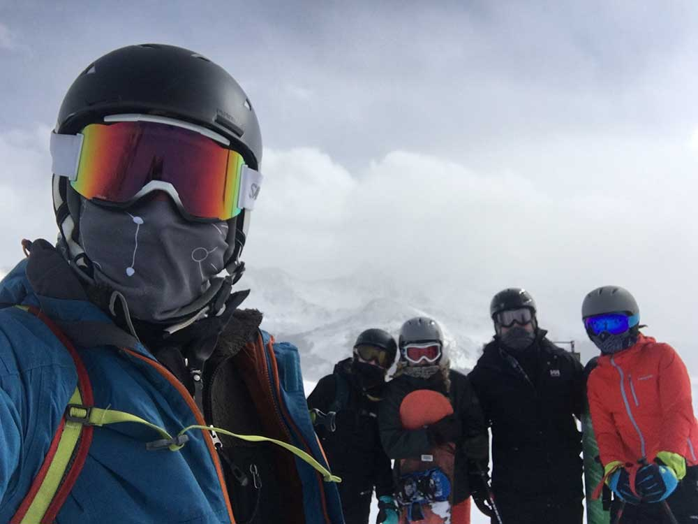 Friends having fun in a group on the mountain while skiing and snowboarding at Copper Mountain