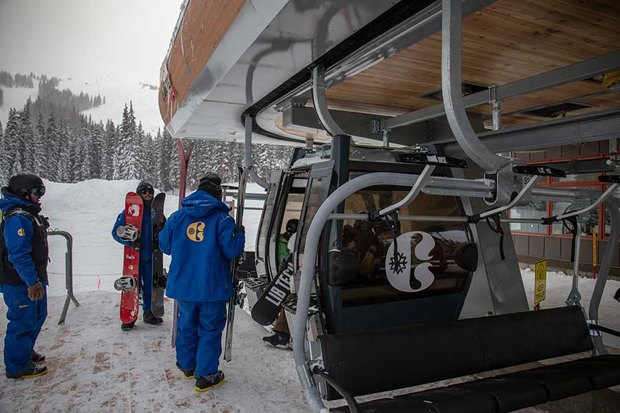 Lift operators help guests get off of the American Eagle lift at Copper Mountain