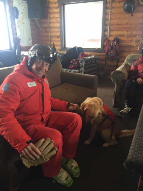 Copper Ski and Ride School Instructor Jeff poses with avalanche dog