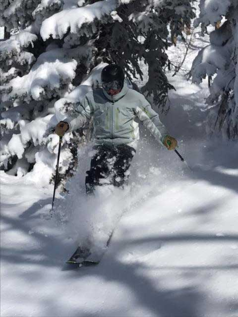 Skier through powder at Copper Mountain