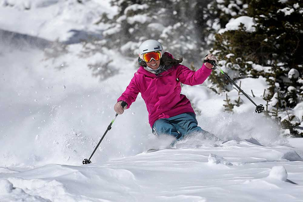 A skier makes turn through powder at Copper Mountain Resort in Summit County, Colorado