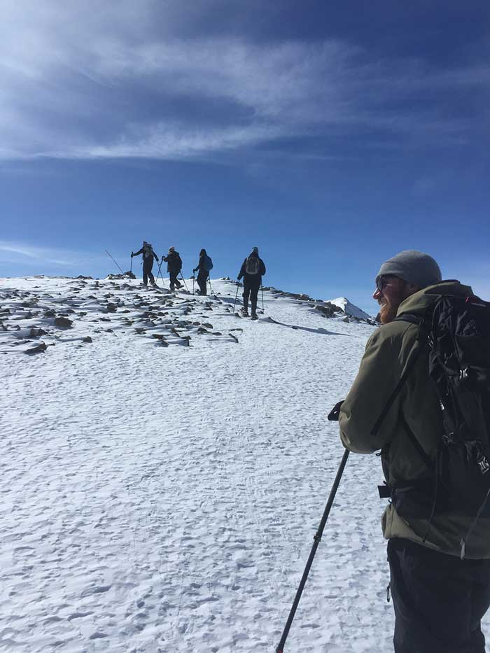 Guests snowshoe up Copper Peak as a part of an REI Adventure program at Copper Mountain